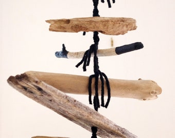 Hippie style hanging decoration in driftwood