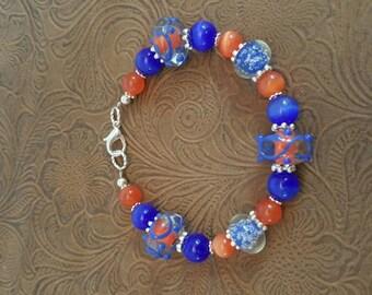 Orange and blue lampwork bead bracelet