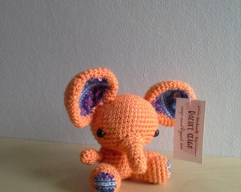 Small orange elephant with blue material detail ears.