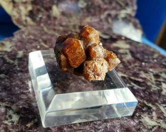 Grossular Garnet crystal cluster, rich orange in color mounted on lucite base