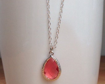 Silver and dark pink / coral framed crystal necklace.