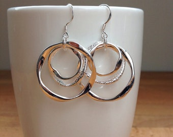 Two-tone matte and glossy silver 3-ring earrings