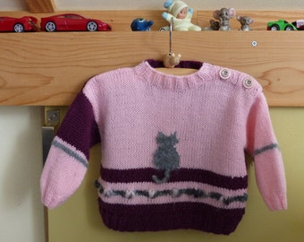 Baby sweater, hand knitted.
