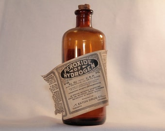 Peroxide of Hydrogen antique amber bottle from T. Eaton Drugs Co., Canada, with original paper label