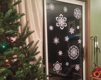 10+ Hand-Cut Paper Snowflakes to Decorate Your Windows