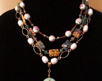 multi-stranded gold-colored necklace