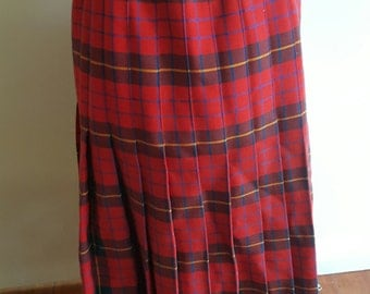 Vintage red pleated tartan wool skirt with red blue and yellow check and a back zip and button in good vintage condition size 14