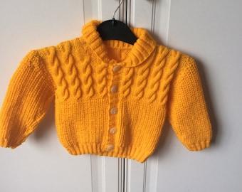 Hand knitted child's yellow cardigan