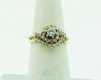 14 K gold diamond engagement ring and wedding band