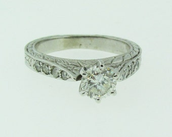 White gold and diamond carved engraved engagement ring.