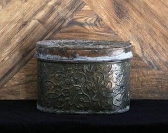 Rustic vintage pressed metal oval tin