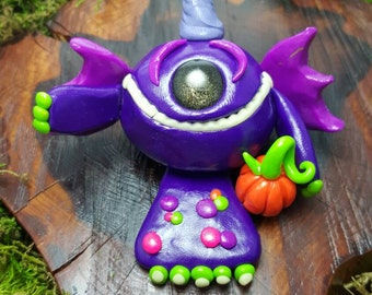 OOAK polymer clay one-eyed, one-horned, one-footed, flying purple people eater!