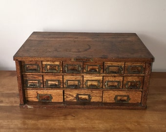Vintage Oak W C Heller & Co parts cabinet with 15 galvanized drawers