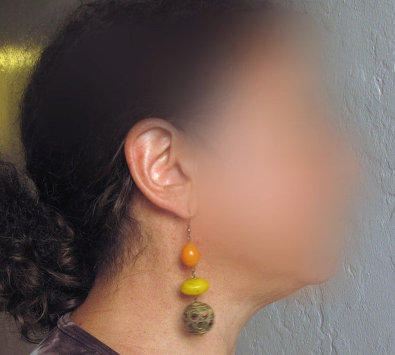 Tribal earrings, orange and yellow plastic beads and bronze metal