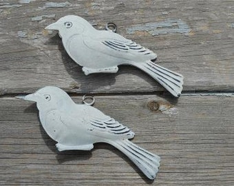 A lovely pair of vintage style patinated what tin hanging birds