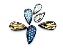 Swarovski vintage flat back crystals which come in three sizes and colours.  Price is for 1 stone