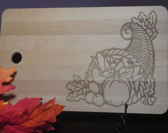 Fall special Cornucopia beech wood cutting board.  Large cutting board etched with cornucopia design and ready for personalization.