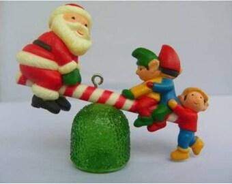 "VINTAGE AVON CHRISTMAS ""Santa See-Saw"" Tree Ornament with Box - 1983"