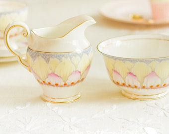 Rare Tuscan hand-coloured art deco 'lotus' cream and sugar set