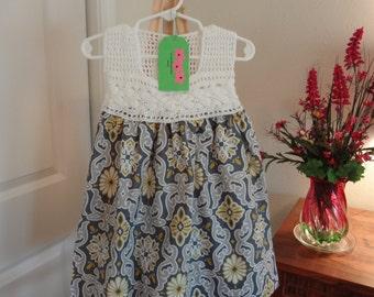 Crochet dress with cotton skirt.