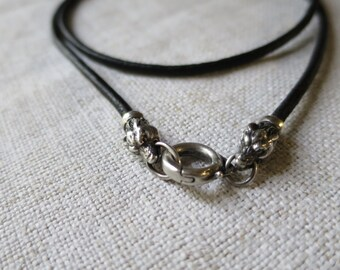 original leather cord with sterling silver clasp wolves