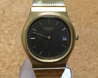 Vintage Caravelle By Bulova Mens Gold Tone Steel Water Resistant Analog Quartz Luxury Dress Watch Hours Clock ~Date~ New Battery