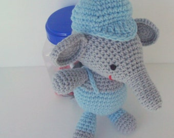Elephant crocheted and stuffed toy.  Dressed in light blue overalls and a cute cap with a bill.