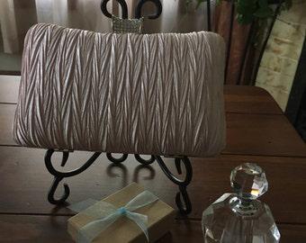 Light pink fabric clutch purse