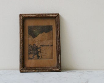 Antique framed etching of man in the woods