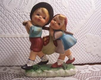Hummel-Like Boy and Girl Carrying a Sack of Apples Figurine, Japan