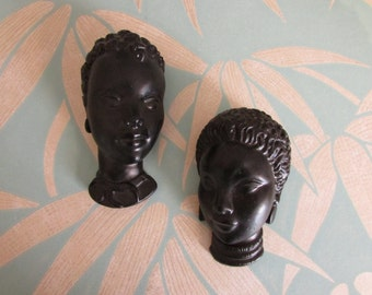 Pair of small vintage Blackamoor tribal wall head/mask plaques