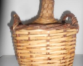Spanish vintage demijohn in wicker basket country decor