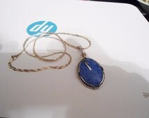 Natural Blue Denim Lapis Free Form Pendant Braided Sterling Silver Necklace Measuring 19 inches in Excellent Condition