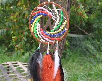 dream catcher with multi colored beads and feathers