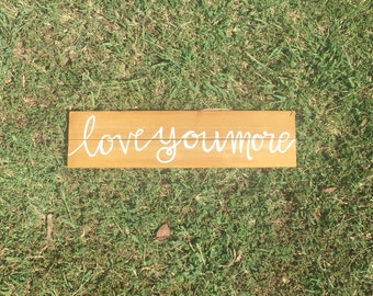 """Wooden handpainted """"Love you more"""" sign"""
