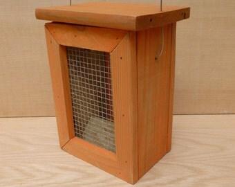 Caged Bird Feeder