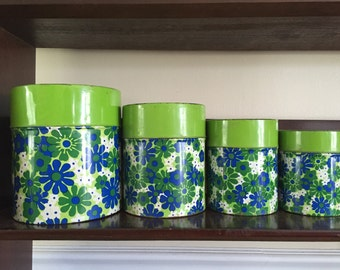 Bright colored blue and neon green floral daisy nesting canister flour sugar coffee tea set for any vintage home or kitchen