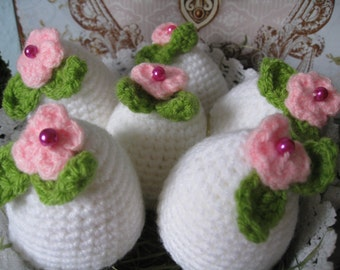 Set of 6 white egg cosies with a small flower and leaves, crocheted