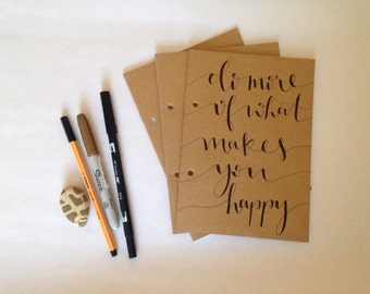 Hand lettered do more of what makes you happy notebook