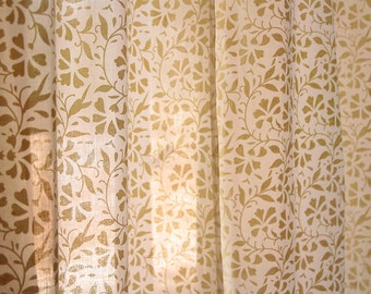 Off-white cotton curtains with pale yellow screen-printed floral motifs