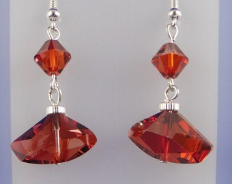 Red Swarovski crystal earrings.  Made with asymetrical faceted triangular shaped crystals