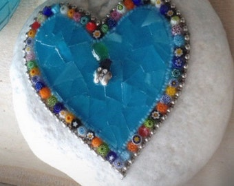 White stone with blue heart