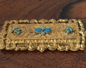 A gilt metal and turquoise Georgian buckle