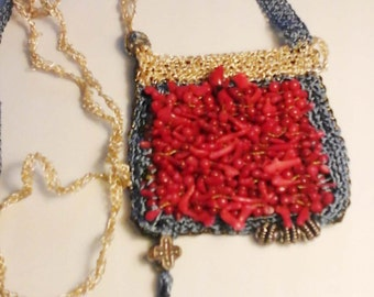 Talisman. Hand woven necklace with coral beads.