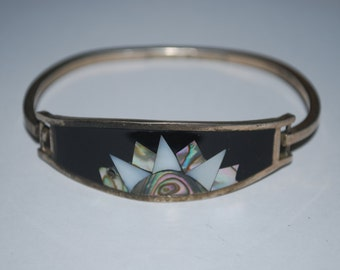 Sterling silver bracelet with shell inlay.