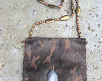 Camaflauge print leather handbag.