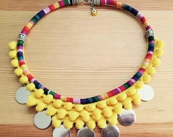 Yellow ethnic necklace with coins.