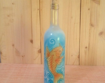 Glass bottle painted with an airbrush