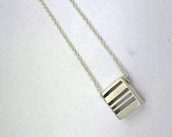 Silver necklace with cubic pendant