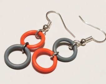 Small grey and coral rubber earrings